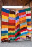 Crochet colorful blanket for sale at gergean street. Crochet colorful blanket for sale at gergean village street stock image