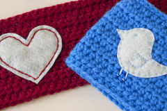 Crochet Crafts. Crafts crocheted out of yarn on a wooden background royalty free stock images