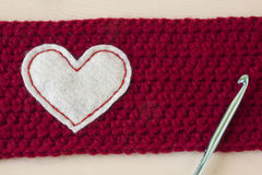 Crochet Crafts. Crafts crocheted out of yarn on a wooden background stock photography