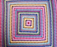 Crochet or crochet blanket on a background. Crochet or crochet blanket on a background stock photo