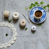 Crochet and a cup of coffee Stock Image