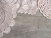 Crochet doilies over old grey wood Royalty Free Stock Photography