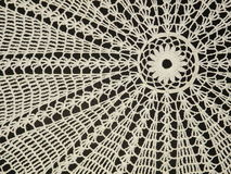 Crochet doily. White crochet doily on the black background Stock Images