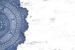 Crochet doily border over shabby chic wood Stock Images