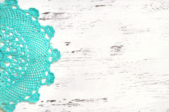 Crochet doily border over shabby chic wood Royalty Free Stock Photography