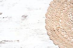 Crochet doily border over shabby chic wood Stock Image
