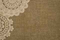 Crochet doily lace  on linen background Royalty Free Stock Photo