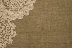 Crochet doily lace  on linen background Royalty Free Stock Photo
