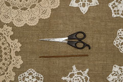 Crochet doily lace  on linen background Royalty Free Stock Image