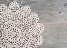 Crochet doily over old grey wood Royalty Free Stock Image