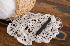 Crochet doily on wooden table Stock Photos