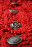 Crochet fabric with metal buttons Royalty Free Stock Photo