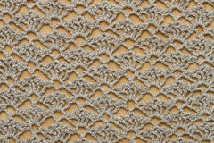 Crochet fabric on wooden board Stock Photo