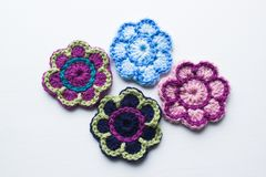 Crochet flowers in different colours. Crochet flowers made with different color wool. Shot in a studio Royalty Free Stock Photography