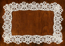 Crochet frame. On wooden table with space for your text Royalty Free Stock Images