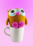 Crochet handmade doll on pink background Royalty Free Stock Photography