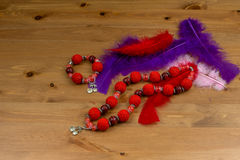 Crochet handmade red bracelet, necklace and feathers Stock Photography