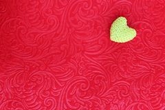 Crochet Heart on red velvet Stock Photo