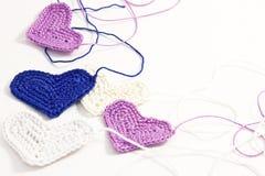 Crochet  hearts with interwoven threads. Crochet little hearts with interwoven threads Stock Photo