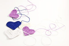 Crochet hearts with interwoven threads. Crochet little hearts with interwoven threads Royalty Free Stock Photo
