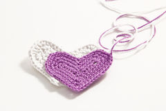 Crochet  hearts with interwoven threads Royalty Free Stock Photography