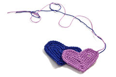 Crochet hearts with interwoven threads Royalty Free Stock Photo