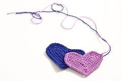 Crochet hearts with interwoven threads. Crochet little hearts with interwoven threads Royalty Free Stock Photography