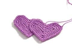 Crochet hearts with interwoven threads Stock Photo
