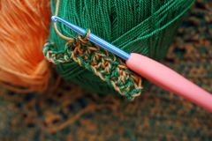 Crochet hook in the process of knitting royalty free stock image