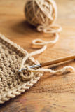 Crochet. Hook on wooden background Royalty Free Stock Images