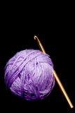 Crochet hook and yarn. Crochet hook and ball of yarn isolated on black Royalty Free Stock Image