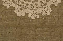 Crochet hooks on linen background. Crochet doily /lace  on linen background Stock Images