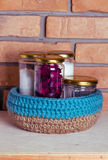 Crochet knitt basket. Crochet basket on brick background Stock Photography