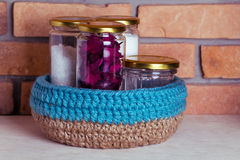 Crochet knitt basket. Hand made basket with jars Royalty Free Stock Image