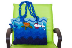 Crochet knitting bag and green chair Royalty Free Stock Photography