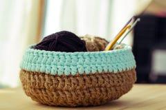 Crochet knitting basket. Crochet basket on wooden background Stock Photography