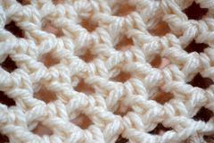 Crochet lace fabric background Stock Images