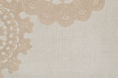 Crochet lace on linen background Royalty Free Stock Images