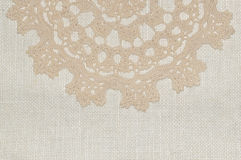 Crochet lace on linen background Stock Image