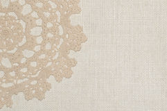Crochet lace on linen background Royalty Free Stock Photography