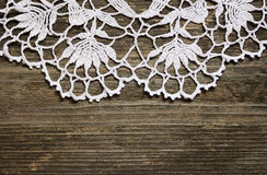 Crochet lace on wood. Crochet lace on a gray weathered wood stock photo