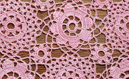 Crochet lace on a wood Royalty Free Stock Images