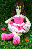 Crochet lady doll. Over green grass background stock illustration