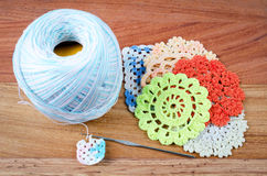 Crochet, the making of a crocheted. On wood background, a retro handmade craft with balls of yarn, color blue Royalty Free Stock Photos