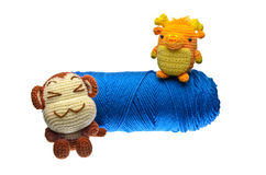 Crochet Monkey and Dragon and Blue Yarn on Isolated White Backgr Royalty Free Stock Photo