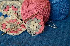 Crochet motives, hook, and cotton yarn Stock Photography