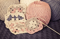 Crochet motives, hook, and cotton yarn Stock Image