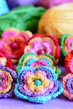 Crochet multi-colored flowers set. Crochet flower motifs and patterns. Interesting hobby for women and children. Closeup. Crochet flowers ornaments and Royalty Free Stock Photography
