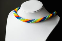 Crochet necklace made from seed beads rainbow colors Stock Photos