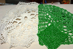 Crochet openwork napkins. Crochet white and green openwork napkins Stock Photos